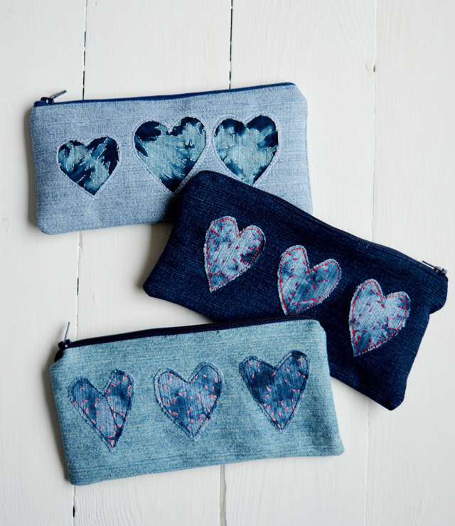 Make a pencil case by using the Shibori method to dye old denim jeans. Reverse appliqué hearts for Valentines Day