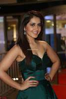 Raashi Khanna in Dark Green Sleeveless Strapless Deep neck Gown at 64th Jio Filmfare Awards South ~  Exclusive 108.JPG