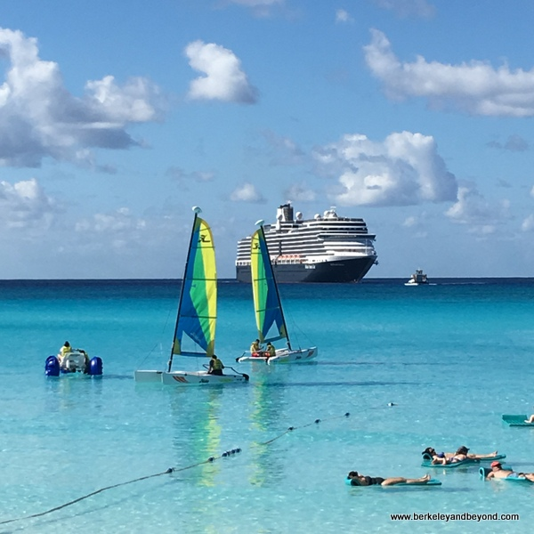 water activities on Half Moon Cay in Bahamas, Holland America Line's Niew Amsterdam in background
