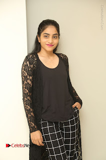 Actress Punarnavi Bhupalam Stills in Black Dress at Pittagoda Press Meet  0023.JPG