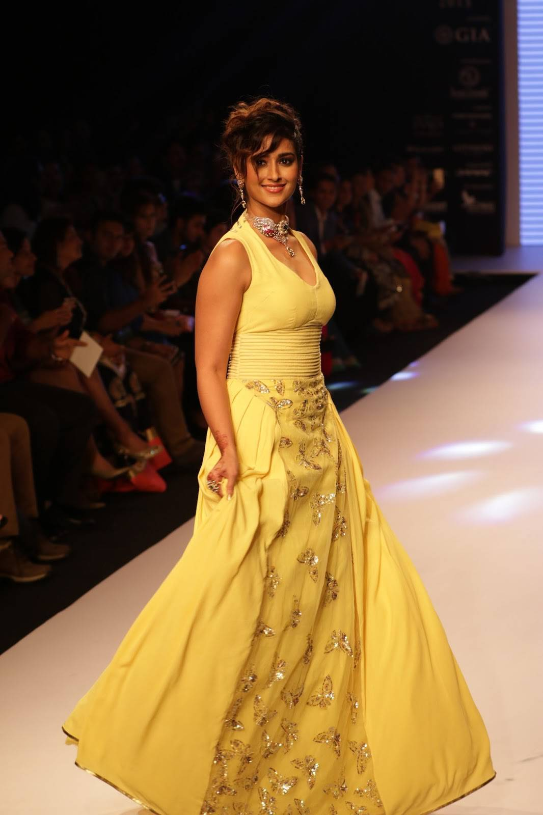 Ileana at IIJW Ramp Walk Hot Photos In Sleeveless Yellow Gown