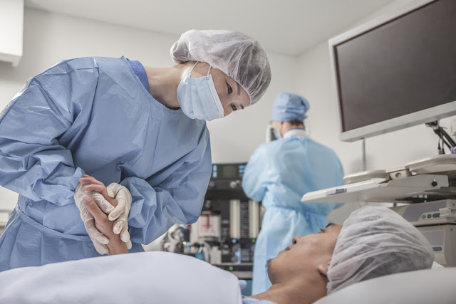 Surgeon reassures patient before surgery