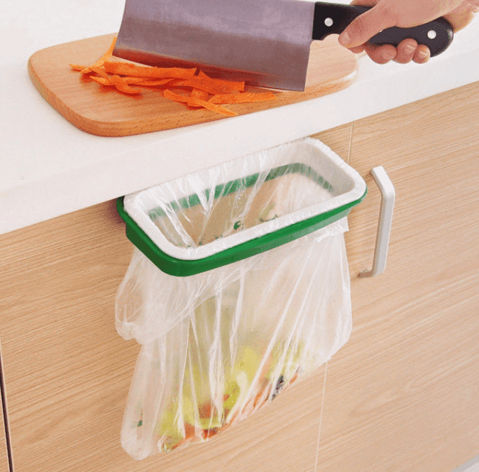 36 Genius Yet Inexpensive Products That Can Save Lives - Clean While You Cook with This Hanging Garbage Bag Holder