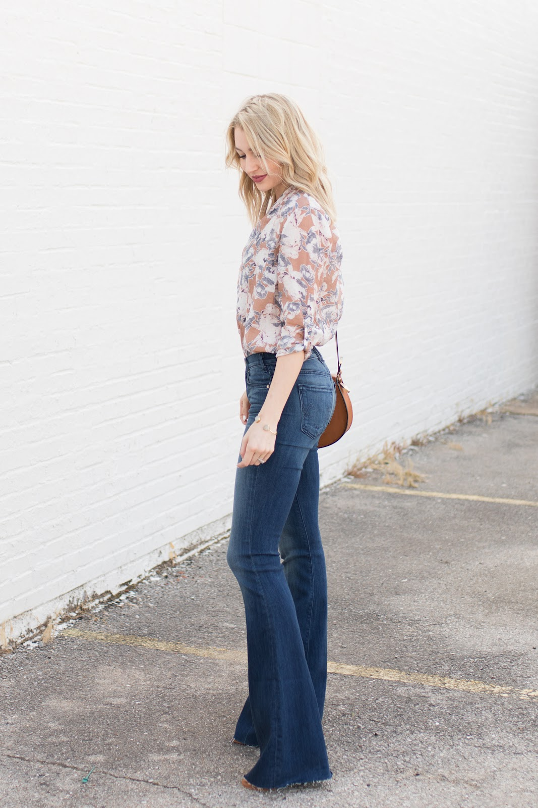Floral blouse tucked into high-waisted flares