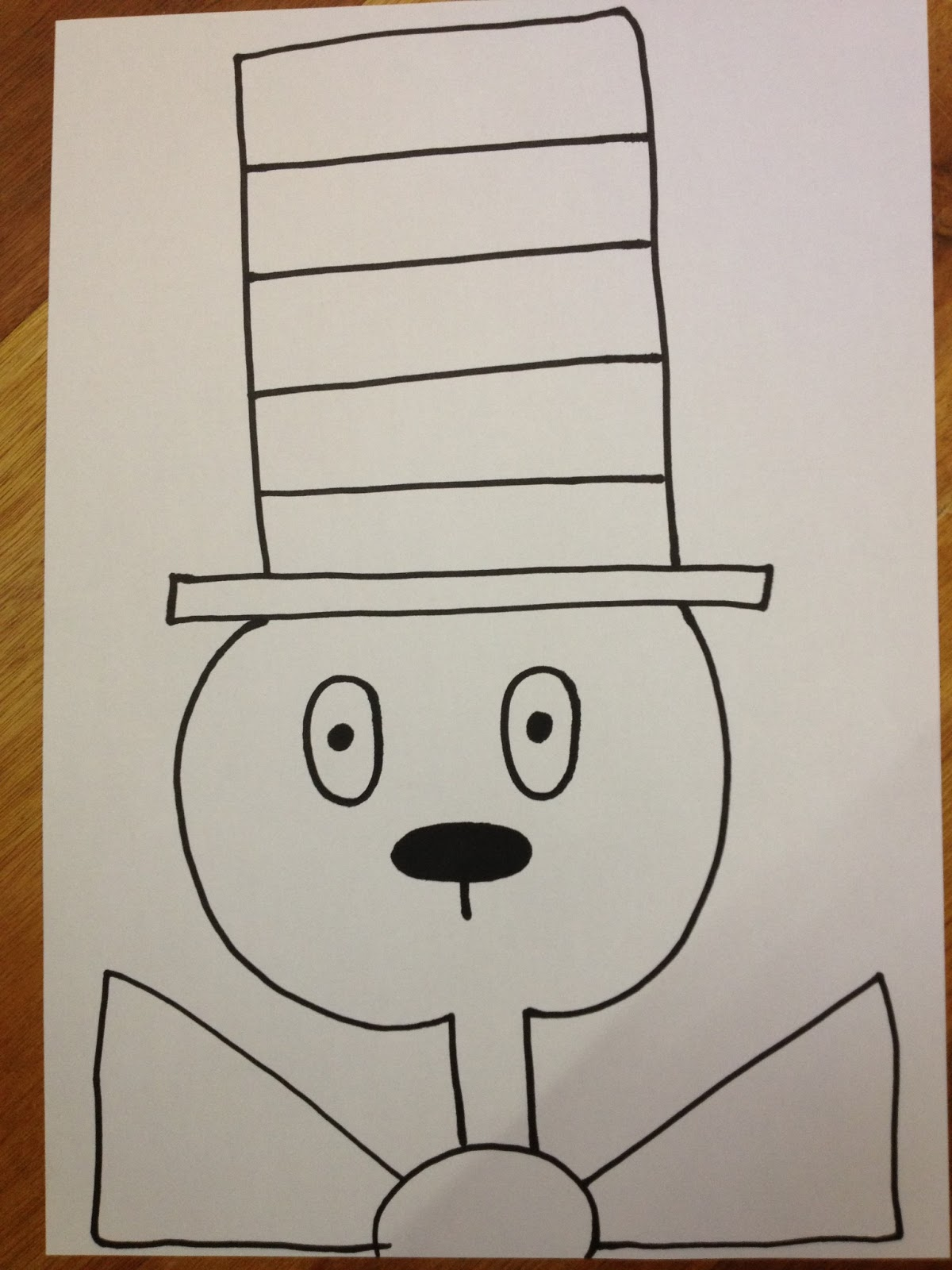 It is a photo of Influential Drawing Cat In The Hat