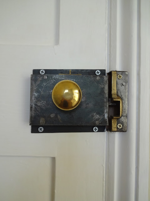 Restored Rim Lock in Bathroom
