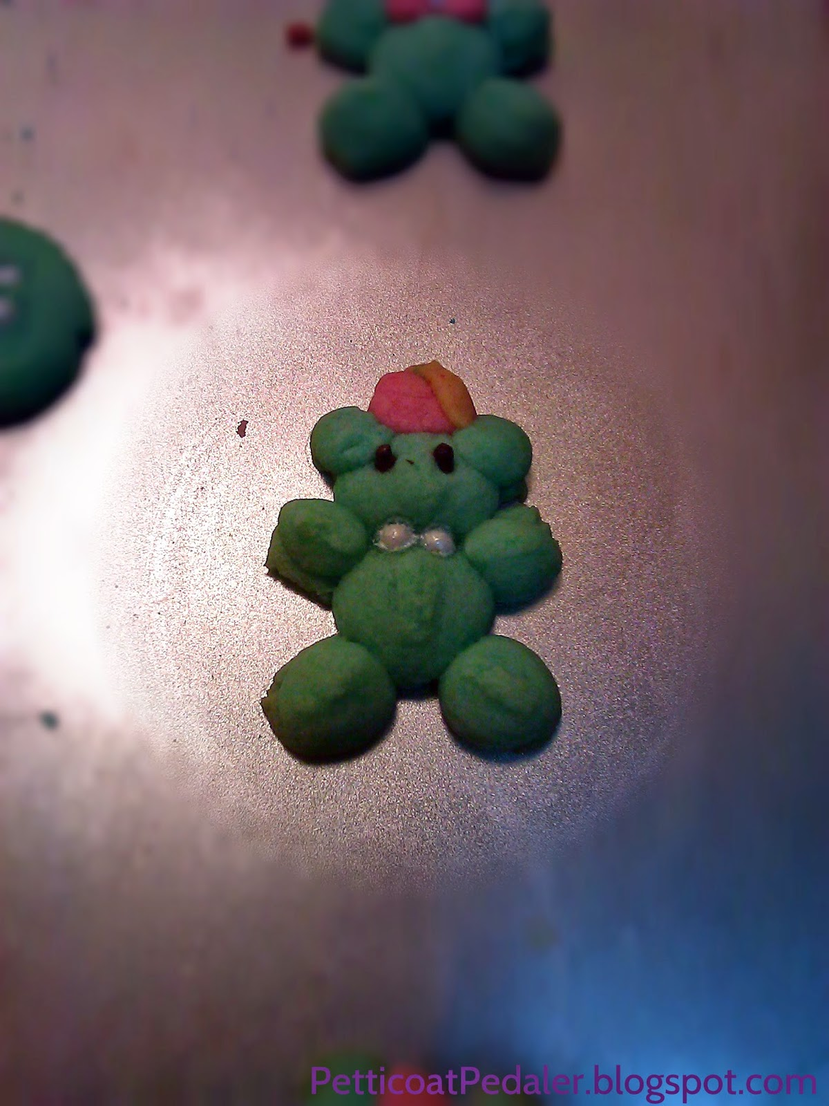 Teddy bear spritz cookie with fez and bow tie