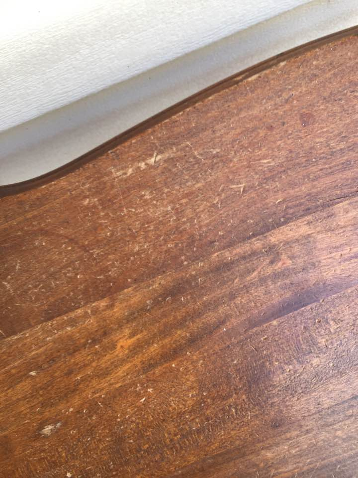 Pits and scratches in wood table top.