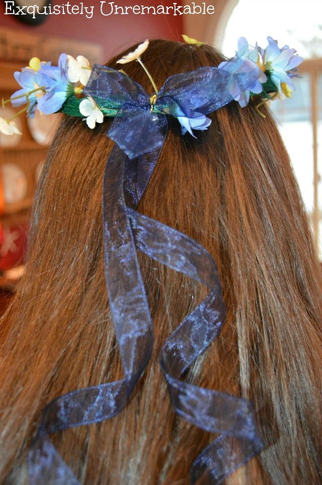 Floral Headpiece on head of brunette girl