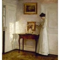 """ A lady reading in an interior"""