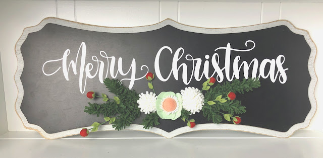 felt flowers decorate a Merry Christmas sign