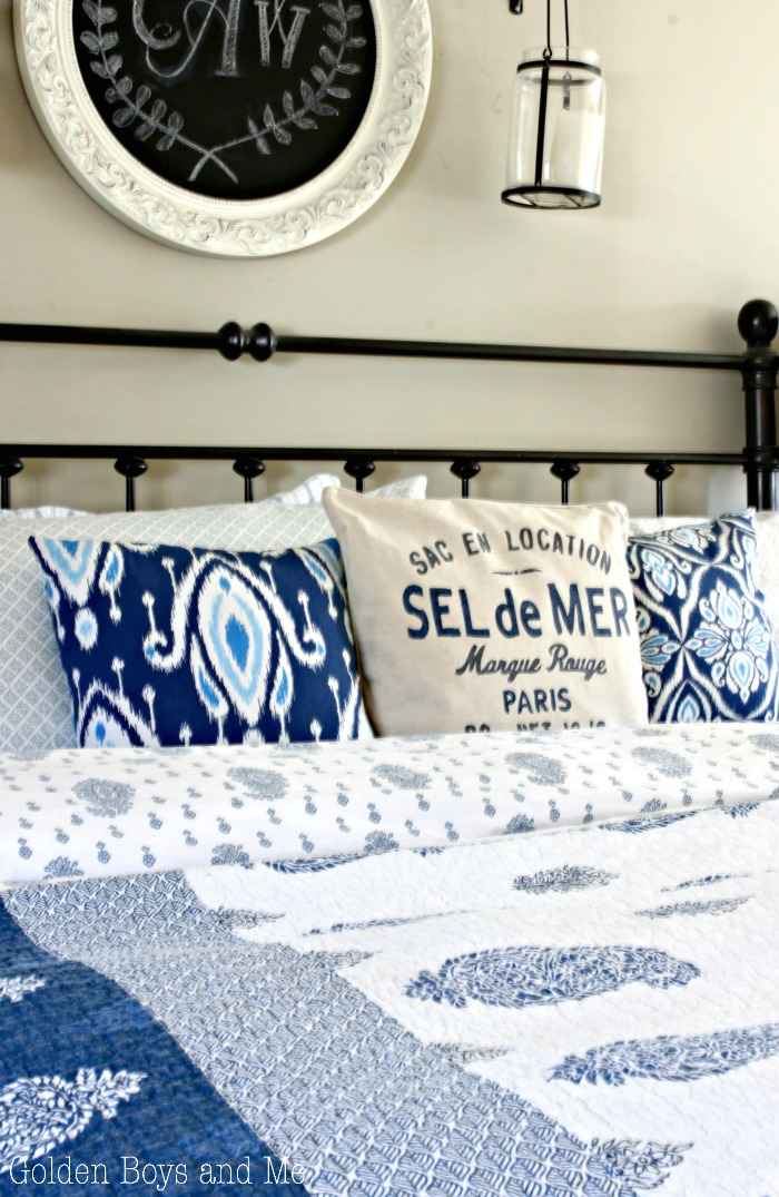 Sel de mer throw pillow in master bedroom with blue and white decor - www.goldenboysandme.com