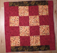 http://quiltsinthehood.blogspot.com/2015/11/placemats-for-ri-meals-on-wheels.html