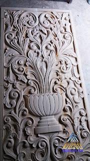 Ukiran dari batu alam paras jogja atau batu paras putih motif ukiran jawa