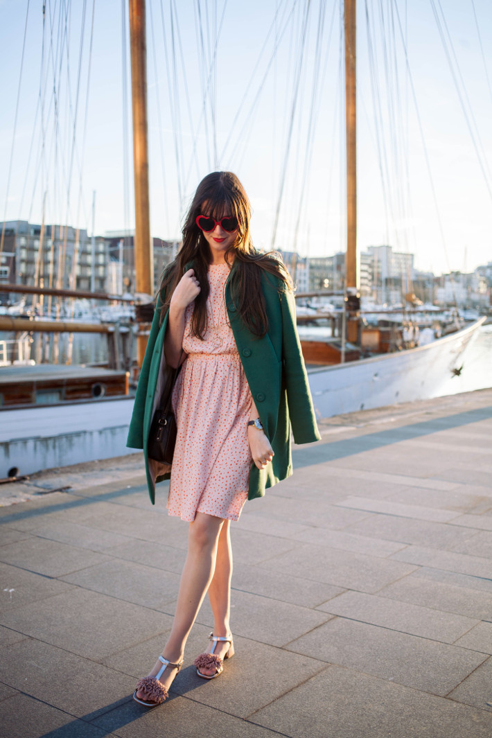 Outfit: heart shaped glasses, pink dress and pom pom shoes