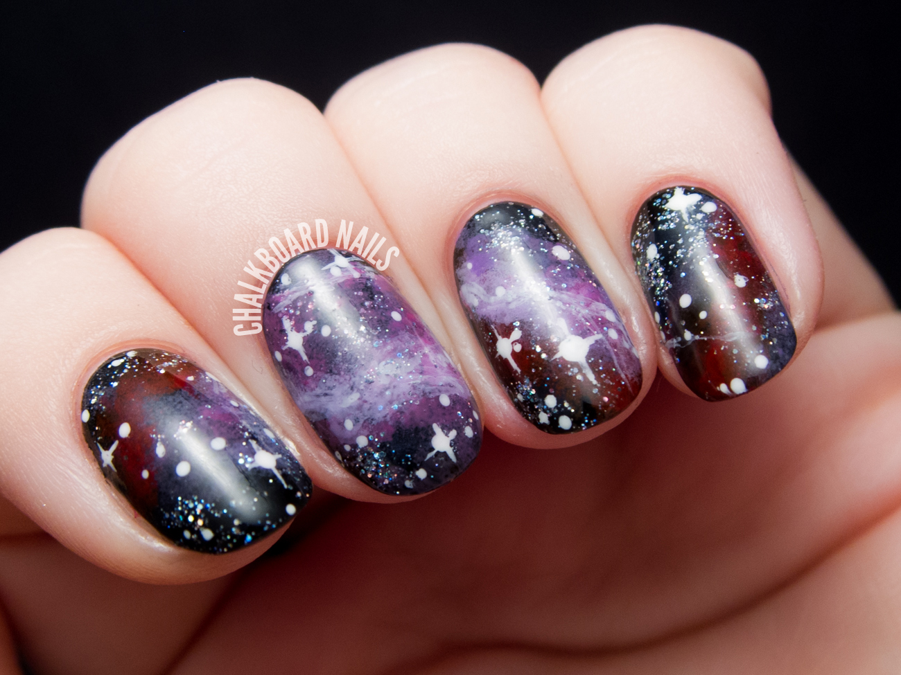 Purple galaxy nail art by @chalkboardnails