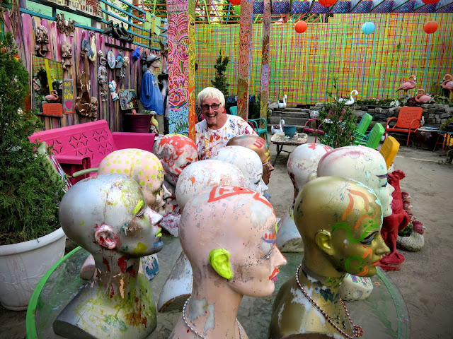 Randy and bald wig stands at Randyland in the Mexican War Streets neighborhood of Pittsburgh