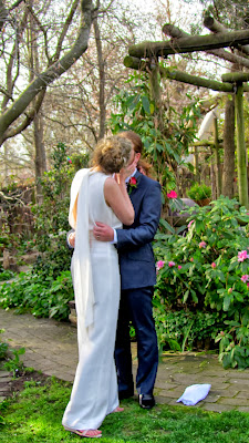 Stephanie and David share a kiss as newlyweds