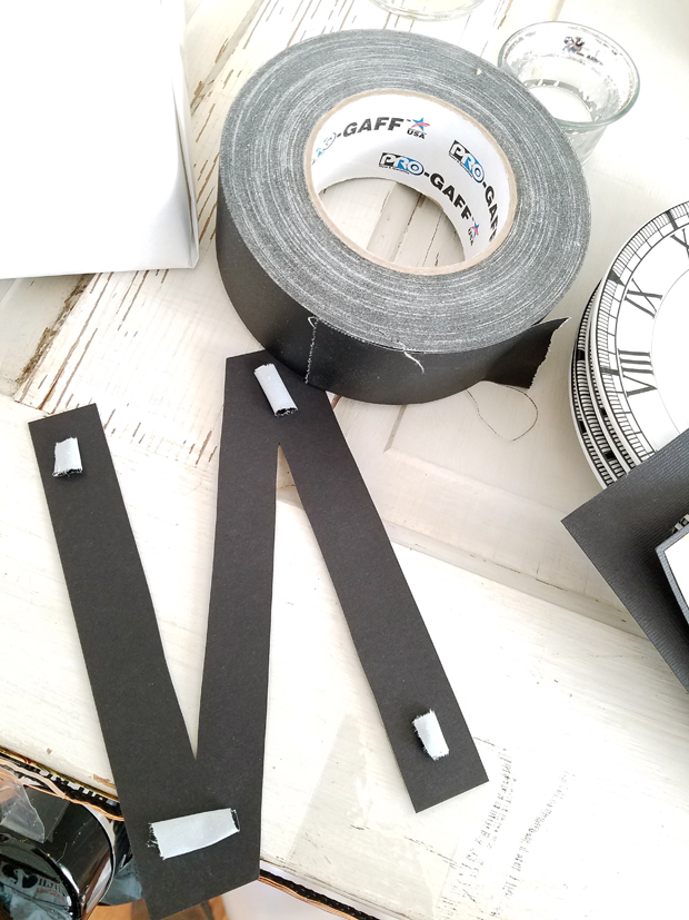 gaffers tape used to attach paper goods on the wall