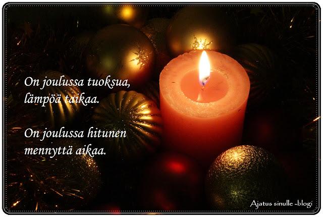 joulukuva tekstillä, kynttilä