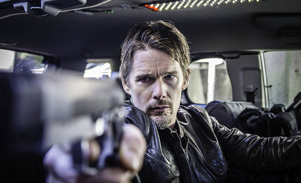 Ethan Hawke plays Travis Conrad in 24 HOURS TO LIVE (2017)