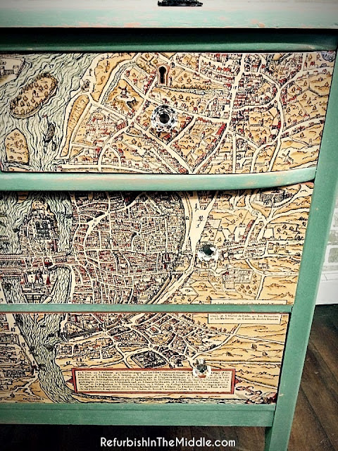 mint green dresser accented with a map print on drawers