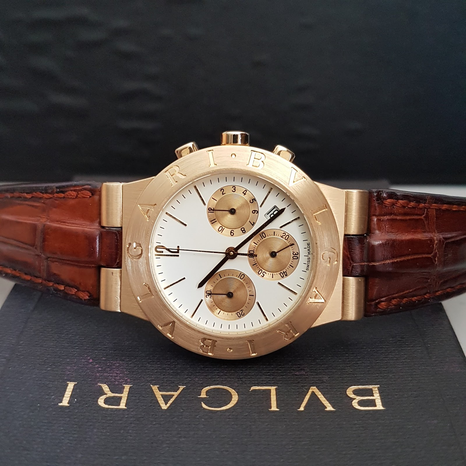 c3e7afa7140 CASE: 18K YELLOW GOLD WITH BULGARI ENGRAVED ON BEZEL STRAP: BROWN CROCODILE  LEATHER WITH 18K YELLOW GOLD TANG BUCKLE GLASS: SAPPHIRE CRYSTAL