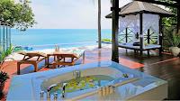 Private teak wooden verandah at The Tongsai Bay Resort at Koh Samui, Thailand