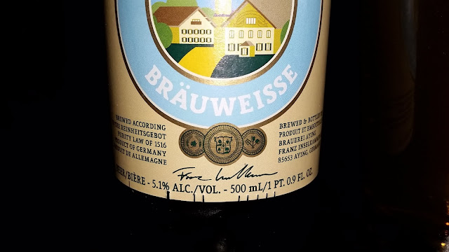 close-up of Ayinger Brauweisse beer bottle - front label