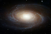 "The sharpest image ever taken of the large ""grand design"" spiral galaxy M81 is being released today at the American Astronomical Society Meeting in Honolulu, Hawaii. A spiral-shaped system of stars, dust, and gas clouds, the galaxy's arms wind all the way down into the nucleus. Though the galaxy is located 11.6 million light-years away, the Hubble Space Telescope's view is so sharp that it can resolve individual stars, along with open star clusters, globular star clusters, and even glowing regions of fluorescent gas. The Hubble data was taken with the Advanced Camera for Surveys in 2004 through 2006. This colour composite was assembled from images taken in blue, visible, and infrared light"
