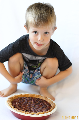 A boy and his German Chocolate Pecan Pie. Tasty!  A classic pecan pie with a delicious chocolate coconut twist.  Easy to make, homemade from scratch, and oh so delicious!  Original recipe. Alohamora Open a Book http://alohamoraopenabook.blogspot.com/