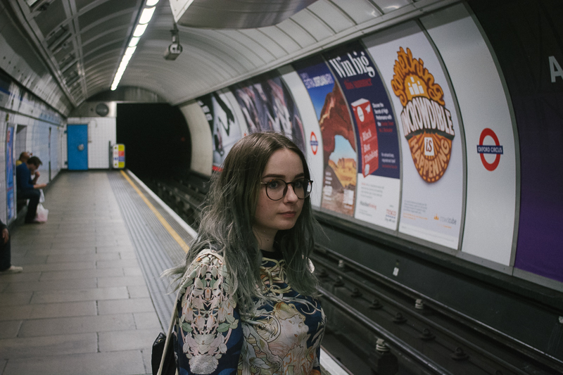 London tube station girl waiting for a train