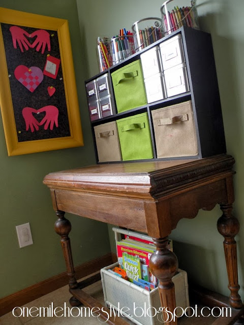 Kids art corner using a side table and cubbies