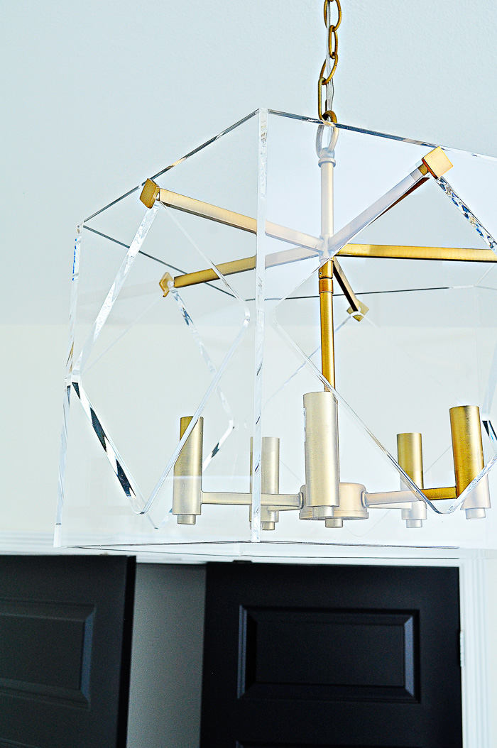 Pentos five light acrylic lucite brass chandelier in an office