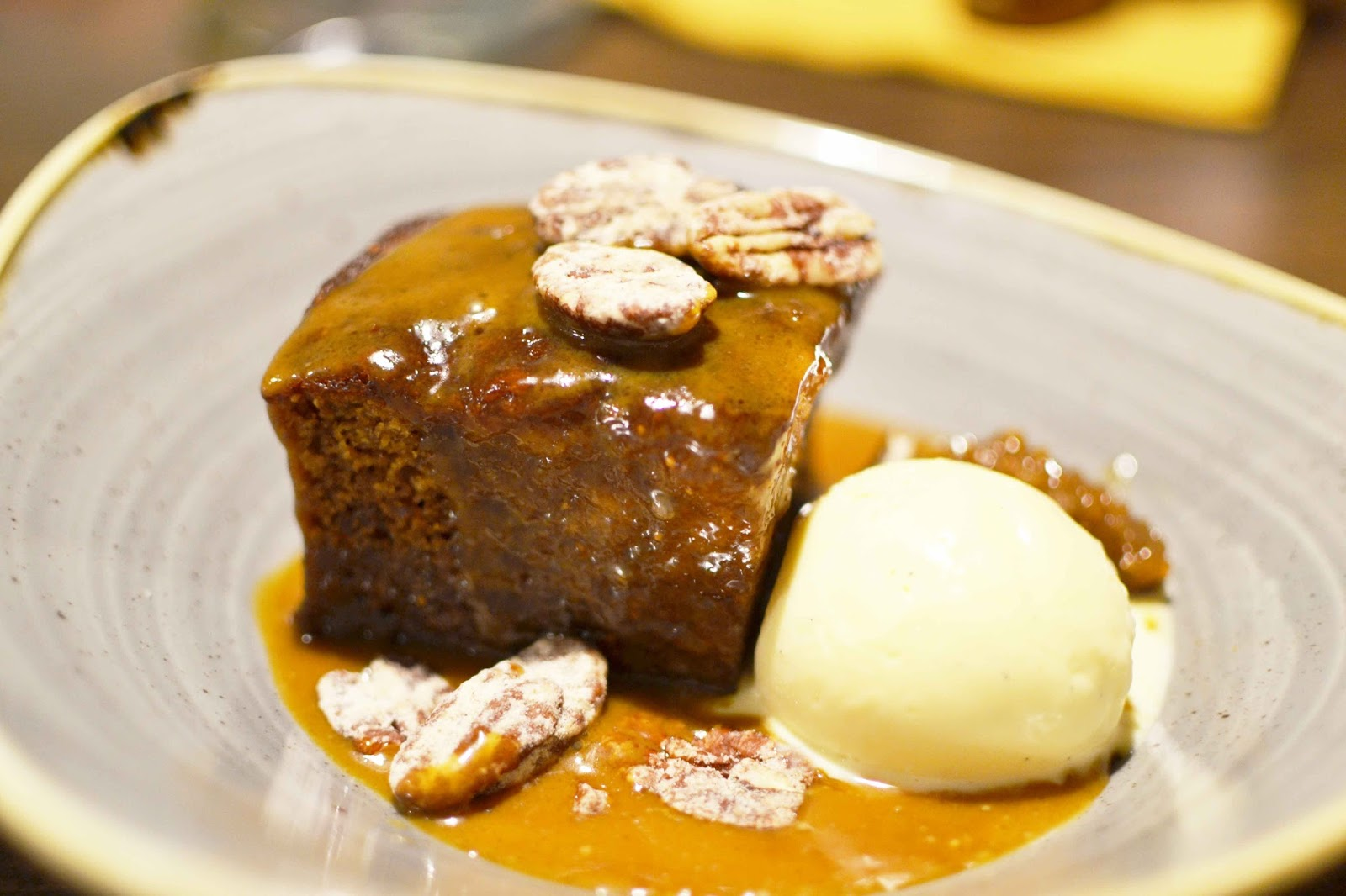 Sticky Figgy Pudding with Toffee Caramel with Candy Pecan and Vanilla Seed Ice Cream.