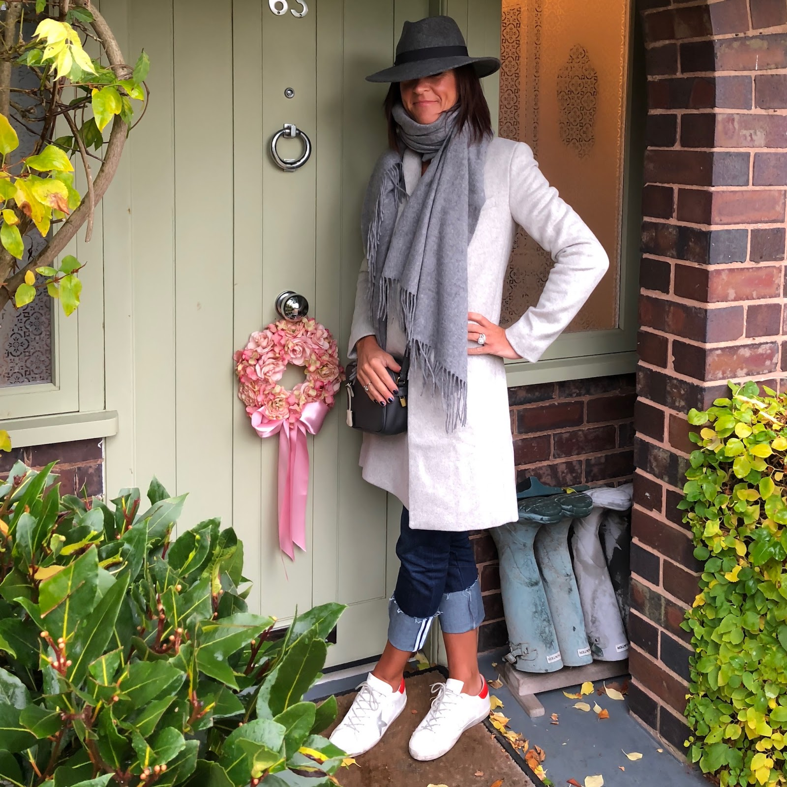 my midlife fashion, great plains nipper wool coat, iris and ink cashmere off the shoulder jumper, asos oversized lambswool scarf, hush turn up boyfriend jeans, golden goose superstar low top lace up trainers, j crew across body leather bag, zara felt fedora hat