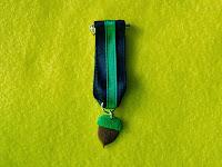 Foto de la medalla bellota hecha de fimo con la que se condecoró al gran Jose María