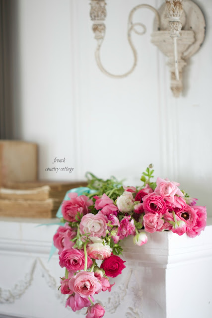 flowers on mantel in cottage