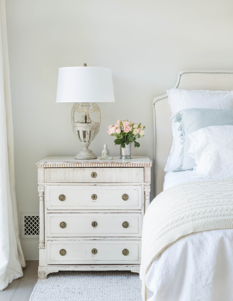 European farmhouse interior design style in a romantic bedroom with Swedish chest - found on Hello Lovely Studio