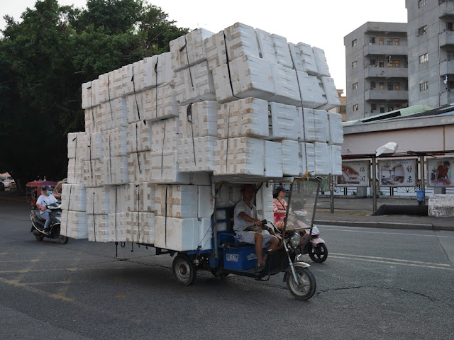 motor tricycle cart carrying many styrofoam containers in Zhongshan, China