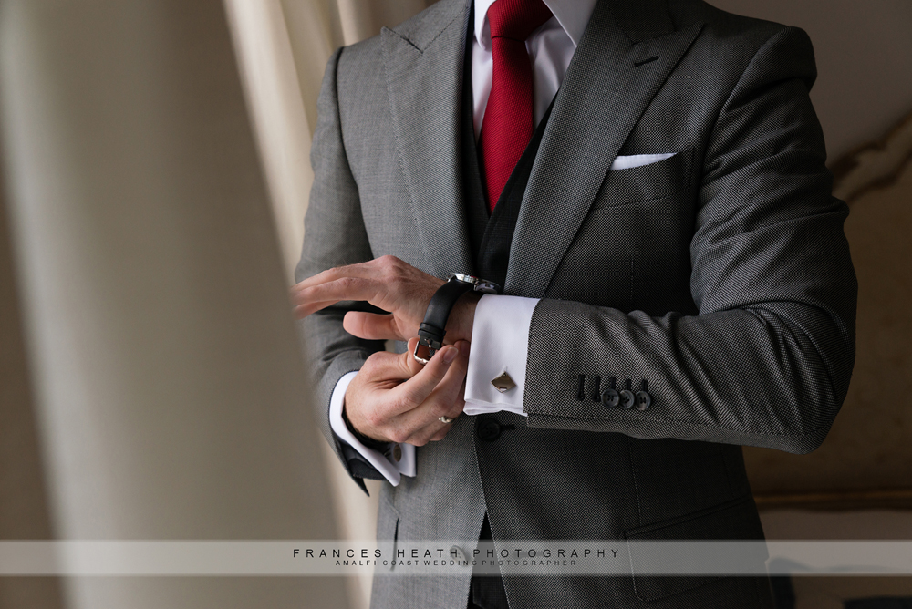 Groom putting on watch