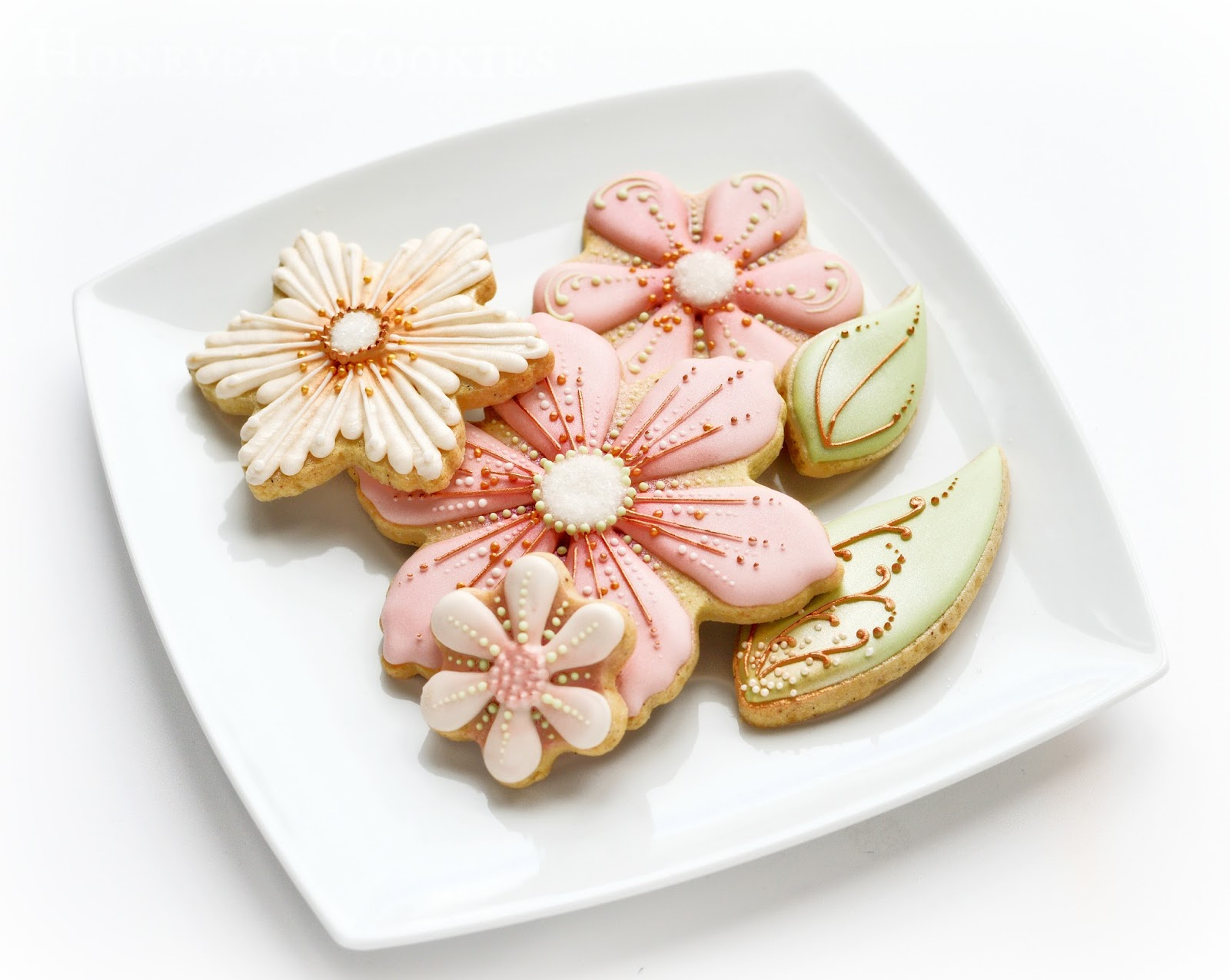 Small plate of stylised cookies, by Honeycat Cookies