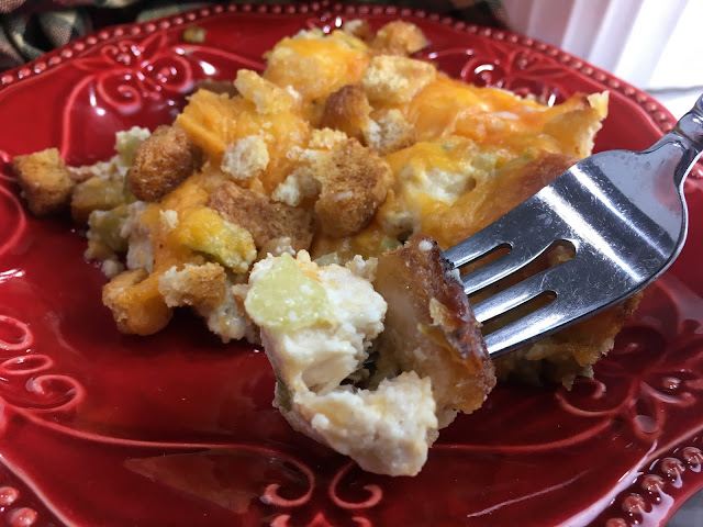 Hot Chicken Salad is a great way to feed a crowd, or serve as an appetizer! This dish is hot and cheesy chicken, and you get a crunch from the celery and croutons!  Chasing Saturday's