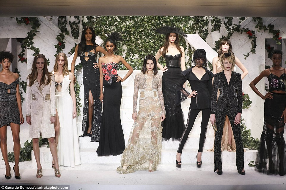 Kendall was centre of attention in her sheer floor-grazing gown in comparison to the all black looks