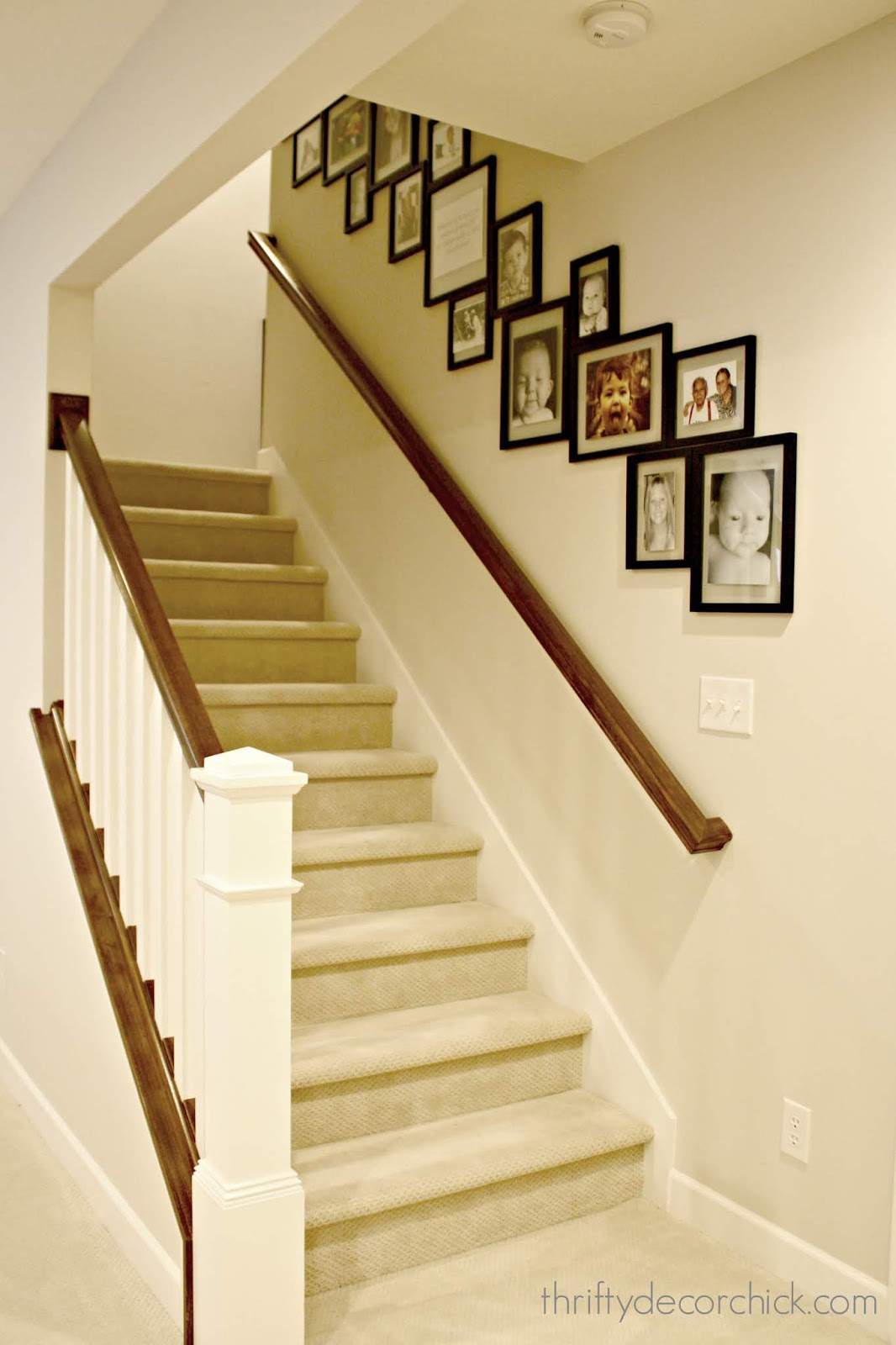 Gallery wall that goes down the stairs