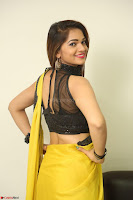 Cute Actress Ashwini in Yellow Saree Exclusive  054.JPG
