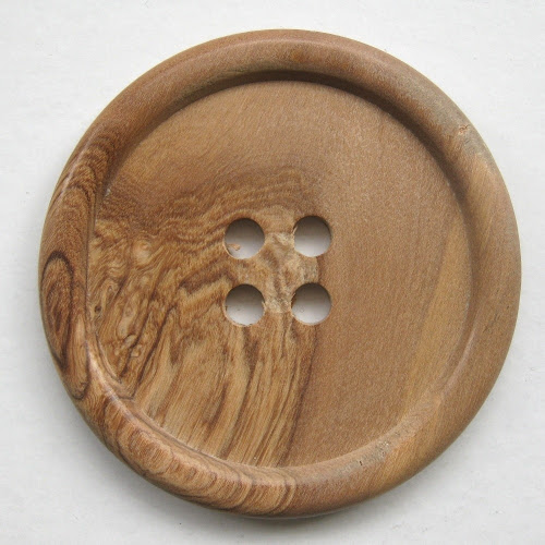http://www.etsy.com/listing/56084984/enormous-wooden-button