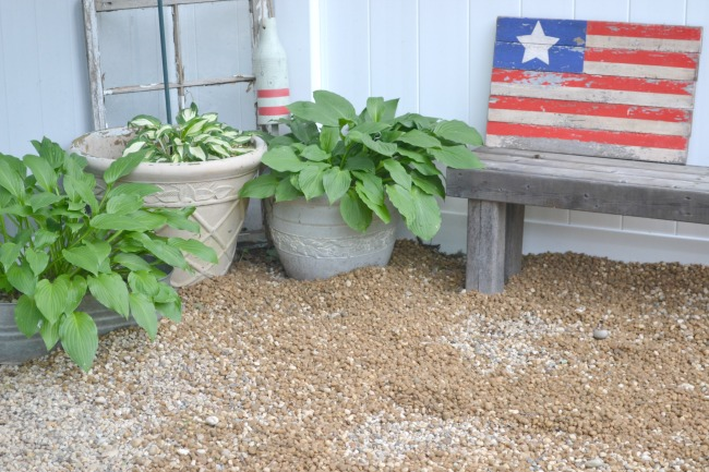 Hosta plants, a bench and American flag