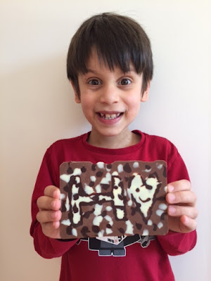 Child and his homemade chocolate bar