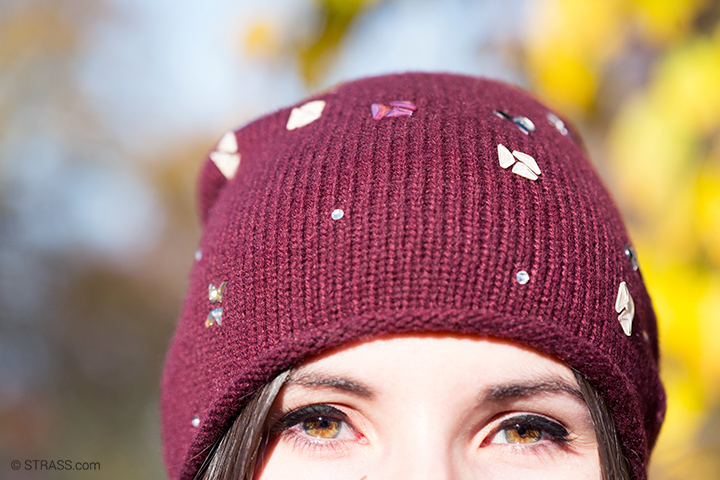 this picture shows a girl wearing our bordeaux colored beanie with Swarovski crystals.